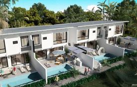Residential for sale in Southeastern Asia. Villa in a condominium surrounded by tropical plants and a magnificent view of the sea in the area of Plai Laem