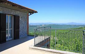 Cheap property for sale in Umbria. Portion of the stone house with large terraces and private land for sale in Umbria