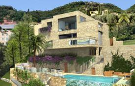 Houses with pools for sale in Menton. Modern design villa close to the promenade and the sea in Menton