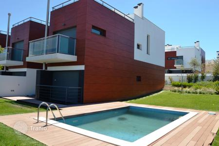 Residential for sale in Lisbon. Modern townhouse with garden and swimming pool in a condo in Oeiras, Portugal