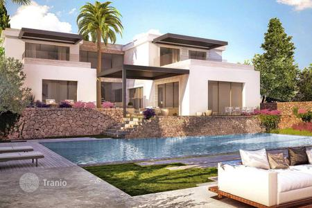 Luxury apartments with pools for sale in Spain. Luxury apartments and villas in a new construction project on the seafront in Nova Santa Ponsa, Mallorca, Spain
