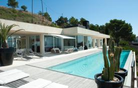 Luxury 4 bedroom houses for sale in Costa Brava. Designer villa with a swimming pool, a glassed-in veranda, a lift and scenic views of the sea and mountains, Begur, Spain