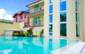 Apartments for sale in Lake Garda. Two-storey penthouse with lake views and a swimming pool, Desenzano del Garda