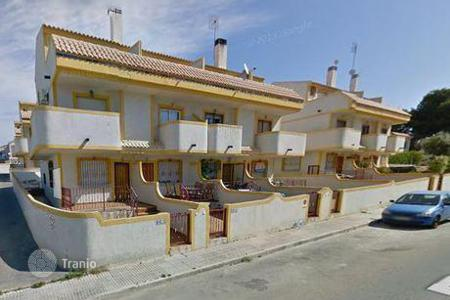 Cheap townhouses for sale in Andalusia. Terraced house - Villamartin, Andalusia, Spain