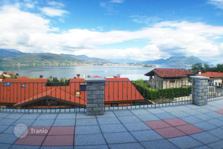 3 bedroom apartments for sale in Italy. New duplex apartment with private garden, garage and terrace with panoramic views of Lake Maggiore, Piemonte, Italy