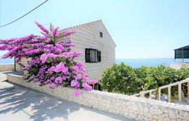 Houses for sale in Split-Dalmatia County. Spacious villa with a guest house, a private garden, a parking and sea views, Selca, Croatia