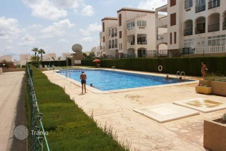 "Cheap apartments with pools for sale in Spain. Torrevieja, Punta Prima, community ""La Cinuelica"", 65 m² apartment located on the ground floor"