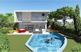 Luxury 5 bedroom houses for sale in Paphos. Comfortable villa with a terrace, a pool and a large plot, on the first line from the sea, Coral Bay, Paphos, Cyprus