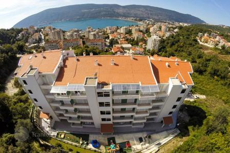 Property for sale in Herceg-Novi. The apartment is in a new residential complex with stunning views of sea and mountains in Herceg Novi, Montenegro