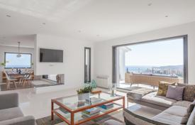 6 bedroom houses for sale in Europe. Modern furnished seaview villa with large terraces, an infinity pool and two garages, Sitges, Spain