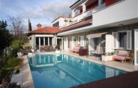 Houses with pools for sale in Slovenia. Six apartments and a wellness area on top floor, pool area, wine cellar, meeting room