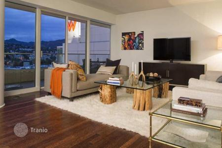 Luxury residential for sale in North America. Furnished apartment with panoramic Hollywood view in condominium with pool on the roof, Los Angeles, USA