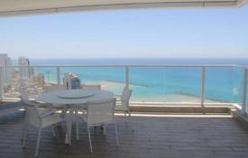 Property for sale in Israel. Modern furnished apartment with a terrace and with stunning views of the sea and the city of Netanya, Israel