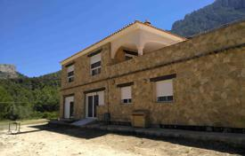 Houses with pools for sale in Finestrat. Two-level stone villa overlooking the mountains in Finestrat, Alicante, Spain