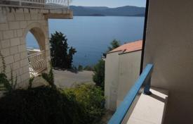 Property for sale in Komarna. Apartments with different layouts in a house on the sea coast, Komarna, Croatia