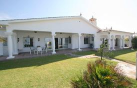 Luxury 3 bedroom houses for sale in Andalusia. Comfortable villa with a private garden, a garage and terraces on the first line from the sea, Marbella, Spain