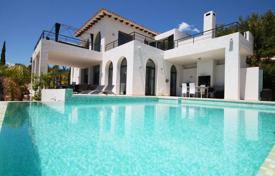 Houses for sale in Altea. Three-level villa with a pool and a garden in Altea Hills, Alicante, Spain