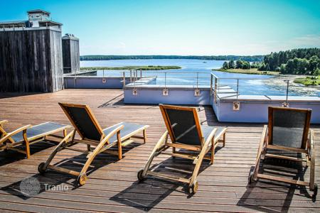 Apartments with pools for sale in Latvia. Respectable apartment with a spacious, open-air terrace in a modern residential complex in Adazi, Riga suburb