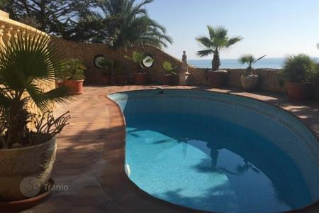 Luxury houses with pools for sale in El Campello. 3 bedroom villa rustic style, with private pool and stunning sea views, fully furnished in El Campello