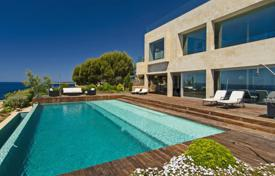 Luxury houses for sale in Cala Pi. Bright and modern frontline villa in Cala Pi, Spain