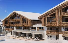 4 bedroom apartments for sale in Auvergne-Rhône-Alpes. Stylish apartment with a balcony and a garden, in a new residence, on a ski slope, 5 minutes drive from the center of Megeve, France
