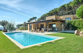 Luxury houses with pools for sale in Costa Brava. Luxury two-storey villa with a pool and a garden, surrounded by mountains and a sea, Begur, Spain