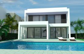 Houses with pools for sale in La Marina. Modern 4 bedroom villa 400 meters from the beach in La Marina