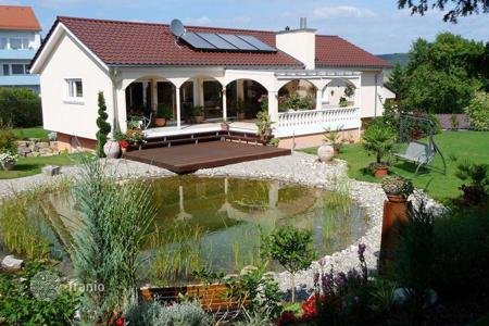 Houses with pools for sale in Germany. A comfortable house with a garden and a pond in Herbrehtingene