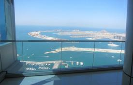 Property for sale in Western Asia. Modern apartment with furniture and stunning views of the sea and the palm island near Dubai Marina
