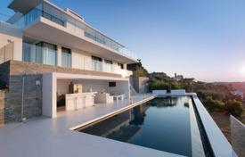 Houses with pools for sale in Vallauris. Modern villa with a garden, a pool, terraces and sea views, Vallauris, France