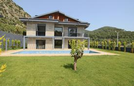 New 6-bedroom villa in Göcek (20 km from Dalaman and 30 km from Fethiye) near the sea, with private swimming pool, garden and jacuzzi for $520,000