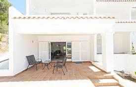 Coastal houses for sale in Ibiza. A two-bedroom semi-detached townhouse with top floor sea views, on a quiet cul-de-sac in a picturesque area, secluded by mountains