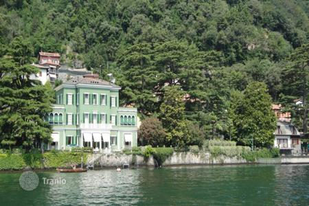 Houses for sale in Laglio. Cozy villa with a big terrace, a garden and a view of the lake Lugano, in Campione d'Italy