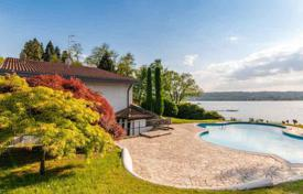 Luxury houses for sale in Sesto Calende. Spacious villa with swimming pool, tennis court and guest house on the shore of Lago Maggiore, with direct access to the dock bay!
