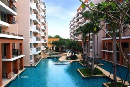 Cheap property for sale in Thailand. Furnished apartment in Pattaya, Thailand. Flat with a balcony, in a modern residential complex with a swimming pool and a gym