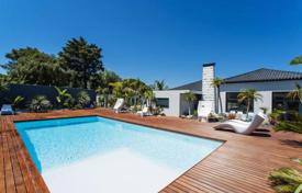 Luxury 4 bedroom houses for sale in Portugal. Modern villa with pool and landscaped yard in Birr, Cascais, Portugal