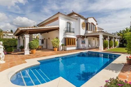 5 bedroom houses by the sea for sale in Andalusia. Three-storey sea view villa with terraces, in a prestigious district, 300 m from the beach, Marbella, Spain. Great investment opportunity!