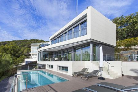 6 bedroom houses for sale in Catalonia. Three-storey luxury villa with panoramic sea views, infinity pool, large terrace and a beautiful garden, Can Girona, Sitges