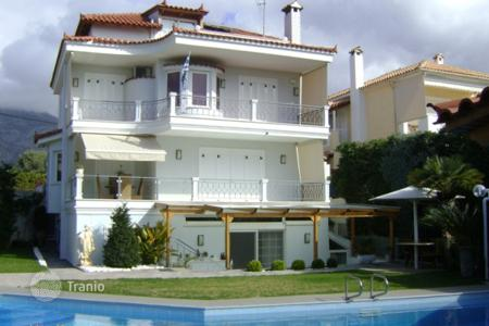 Houses with pools by the sea for sale in Attica. Modern sea view estate with a swimming pool and an independent apartment, at 850 m from the beach, Lagonissi, Greece