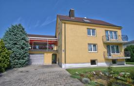 Luxury residential for sale in Munich. Comfortable cottage with a rooftop terrace, a winter garden, a large plot and a guest apartment, Munich, Bavaria, Germany