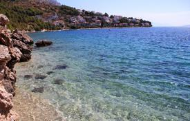 Coastal development land for sale in Omis. Plot for a villa, 10 meters from the sea, Omiš, Croatia
