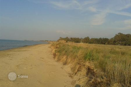 Coastal land for sale in Kyllini. kilini Ilia. Beachfront plot 35,310 m² (first line), flat, buildable suitable for residential or tourist development