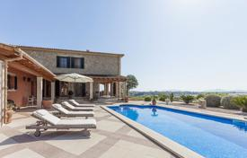 Houses with pools for sale in Majorca (Mallorca). Two-storey villa with a facade from natural stone, a swimming pool, a covered terrace and a sauna, Maria de la Salud, Mallorca