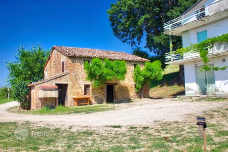 Houses for sale in Marche. Country house to renovate with land and sea view