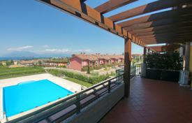 Apartments for sale in Lake Garda. Penthouse with panoramic lake view in Desenzano del Garda