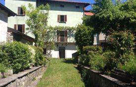 Cheap houses for sale in Italian Lakes. Three-storey house with a garden, a garage and panoramic views, Pellio Intelvi, Italy