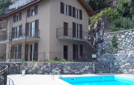 Apartments with pools for sale in Colonno. A new Residence in Colonno with pool and stunning lake and mountain views!