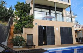 4 bedroom houses for sale in Sitges. Modern three-storey villa with a pool and a summer kitchen, on the hillside, overlooking the sea and the city, Sitges, Spain