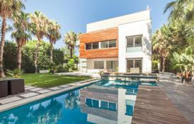 Luxury houses with pools for sale in Catalonia. Exclusive furnished villa with a swimming pool, a landscaped garden and a garage, close to the beach, Gava Mar, Spain