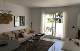 Property for sale in Andalusia. Two-bedroom apartment with a terrace and a sea view in a residence with a swimming pool and a garden, Nueva Andalucia, Marbella, Spain